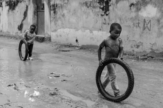 until it's too late to capture what's important to us. Children playing in the street -