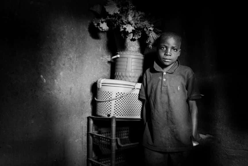 the 8 year-old boy who takes care of his baby brother - Kunje, An- gola. DEVELOPING