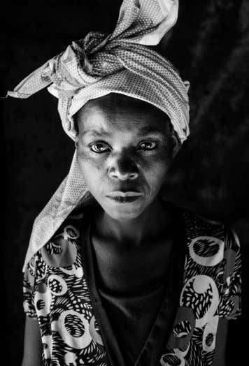 Soba Agostinho, one of his wives and daughter - Nanjengue, Angola. DEVELOPING A DOCUMENTARY PHOTOGRAPHY