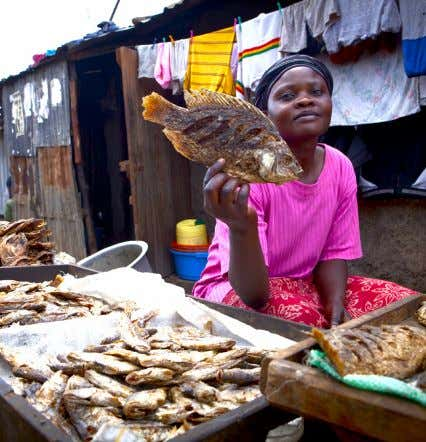 "unity for prosperity of the nation as a whole,"" she says. Carol Akinyi displays her fish"