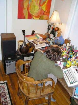 Peter at a desk, with his favorite typewriter, opera records in the background. (courtesy Mary X)