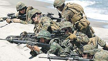 missions and disaster-response drills. Next page Beach landing. US and Philippine marines take their