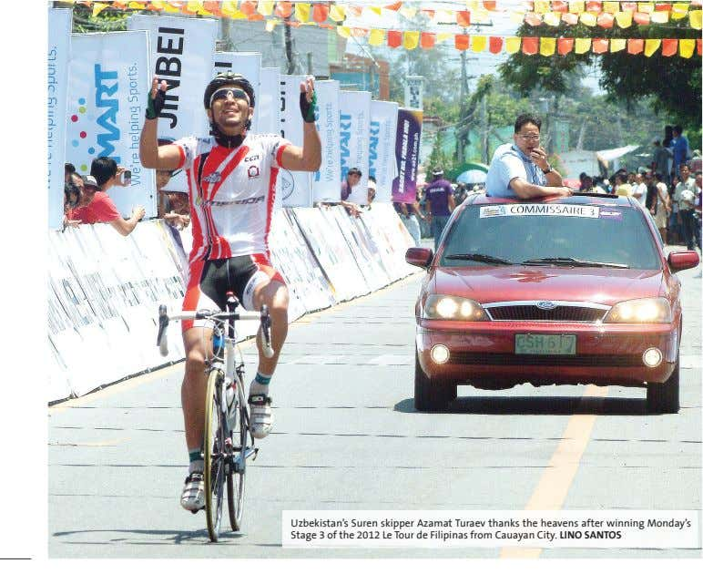 Uzbekistan's Suren skipper Azamat Turaev thanks the heavens after winning Monday's Stage 3 of the