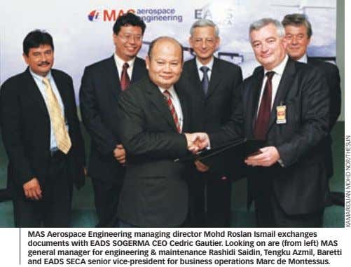 MAS Aerospace Engineering managing director Mohd Roslan Ismail exchanges documents with EADS SOGERMA CEO Cedric