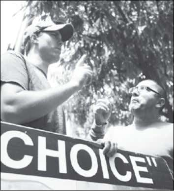 with issues about this policy. ArGUING ABoUT ABorTIoN dth/allison russell P rotesters argue at a rally