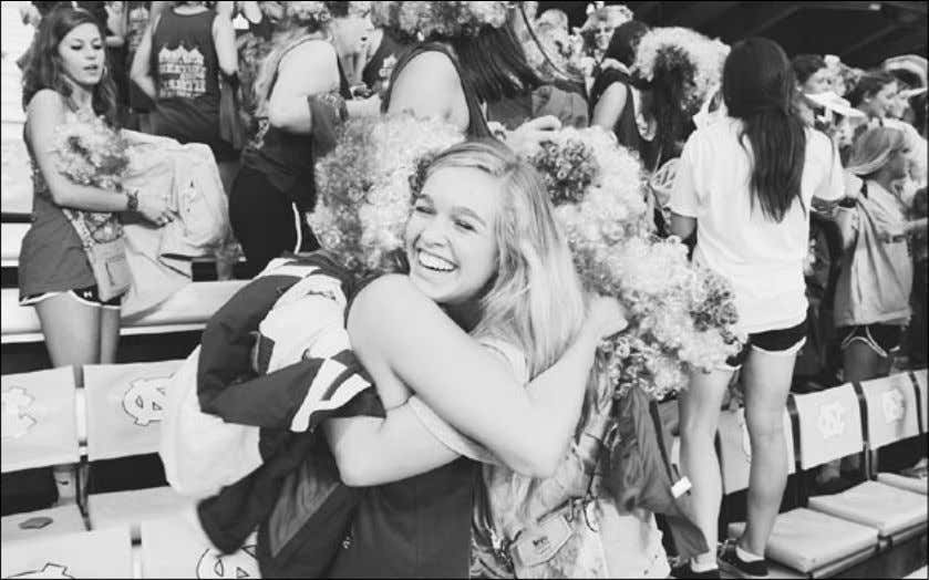 BID DAY, RAIN OR SHINE dth/erin hull L izzy Barringer hugs one of her new sorority