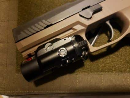 the shooter to break his or her grip to operate the light. Accessing the mode selector