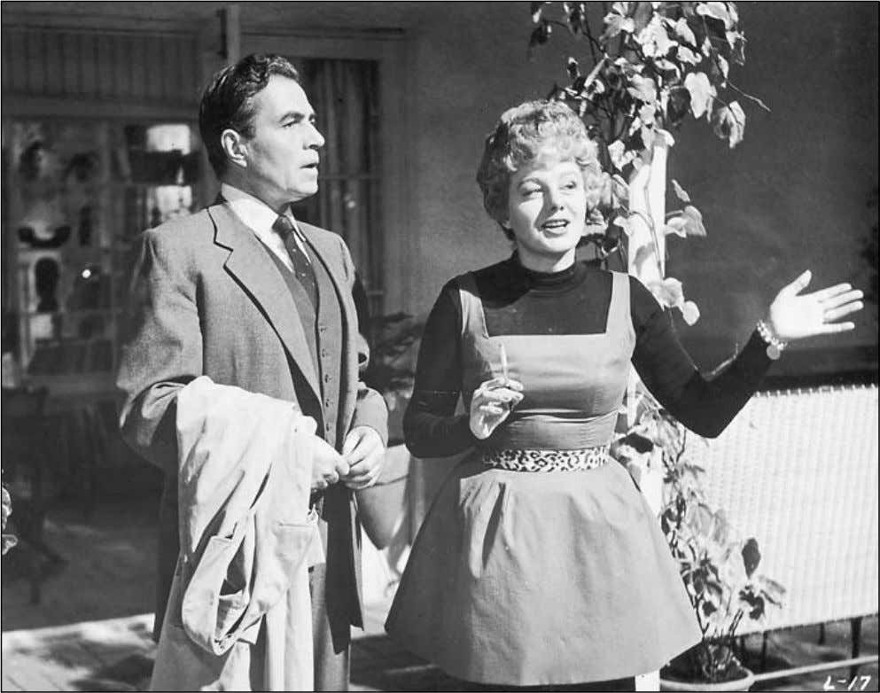 84 ERIC SCHAEFER Charlotte Haze (Shelley Winters) introduces Humbert Humbert (James Mason) to a cul- ture