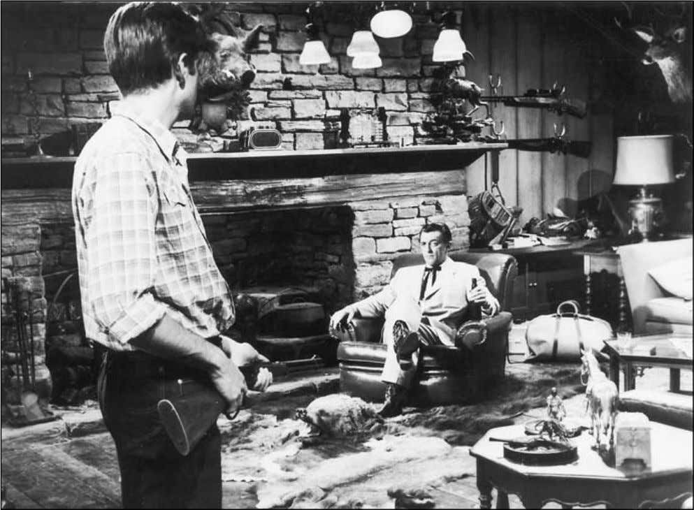 30 CHRISTOPHER SHARRETT The hypermasculine décor of the den of Capt.Wade Hunnicut (Robert Mitchum) in Home