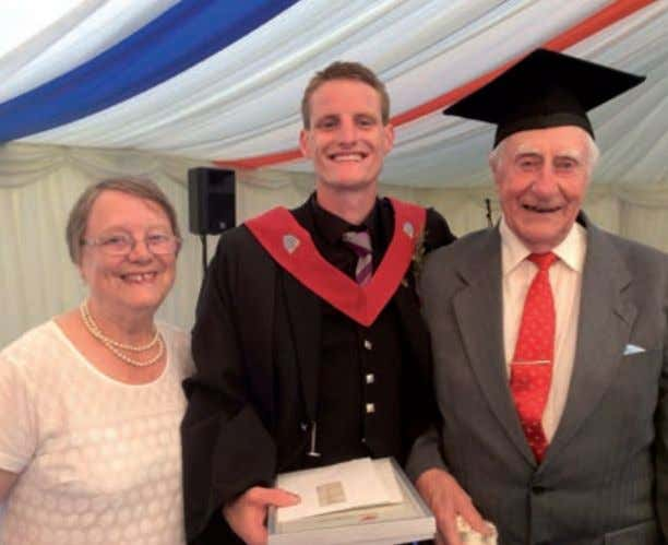 WORLD PUMPS May2017 Jamie at his graduation in 2014 with his grandparents, Peter and Sheila Knight.