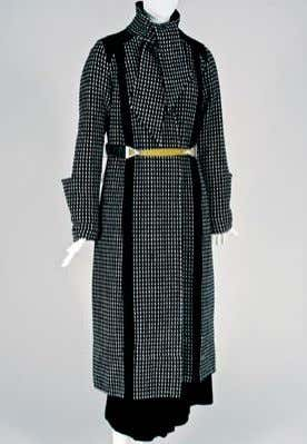 This avant-garde Poiret ensemble is from about 1919. The coat is fabricated in a single