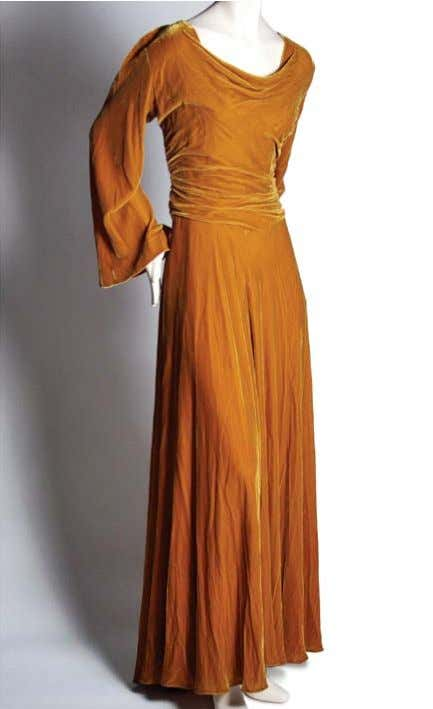 This timeless evening gown is fabricated in silk velvet. A very successful New York designer,