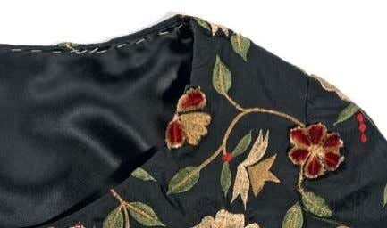 To be worn over a long black dress, this cropped top was assembled with appliqué