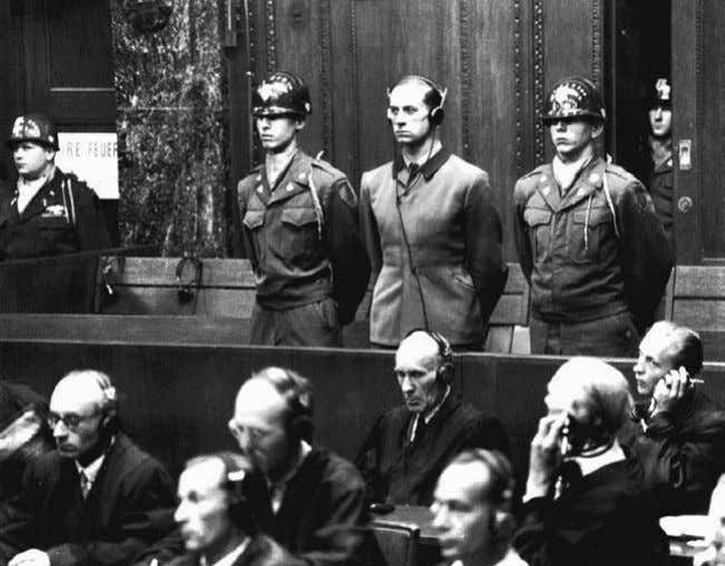 Euthanasia enthusiast Dr. Karl Brandt (standing, center) in the dock at the Nuremberg Trials in