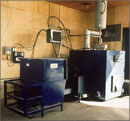 Figure 1 shows a small commercial biomass heating system. Figure 1: Small Commercial Biomass Heating System.