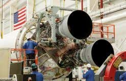 of a metal or composite casing filled Launch Vehicles Two RD-181 beng integrated with an Antares