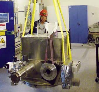 room. In order to accommodate the new instruments, the Figure 1. The MIDI cryostat is craned