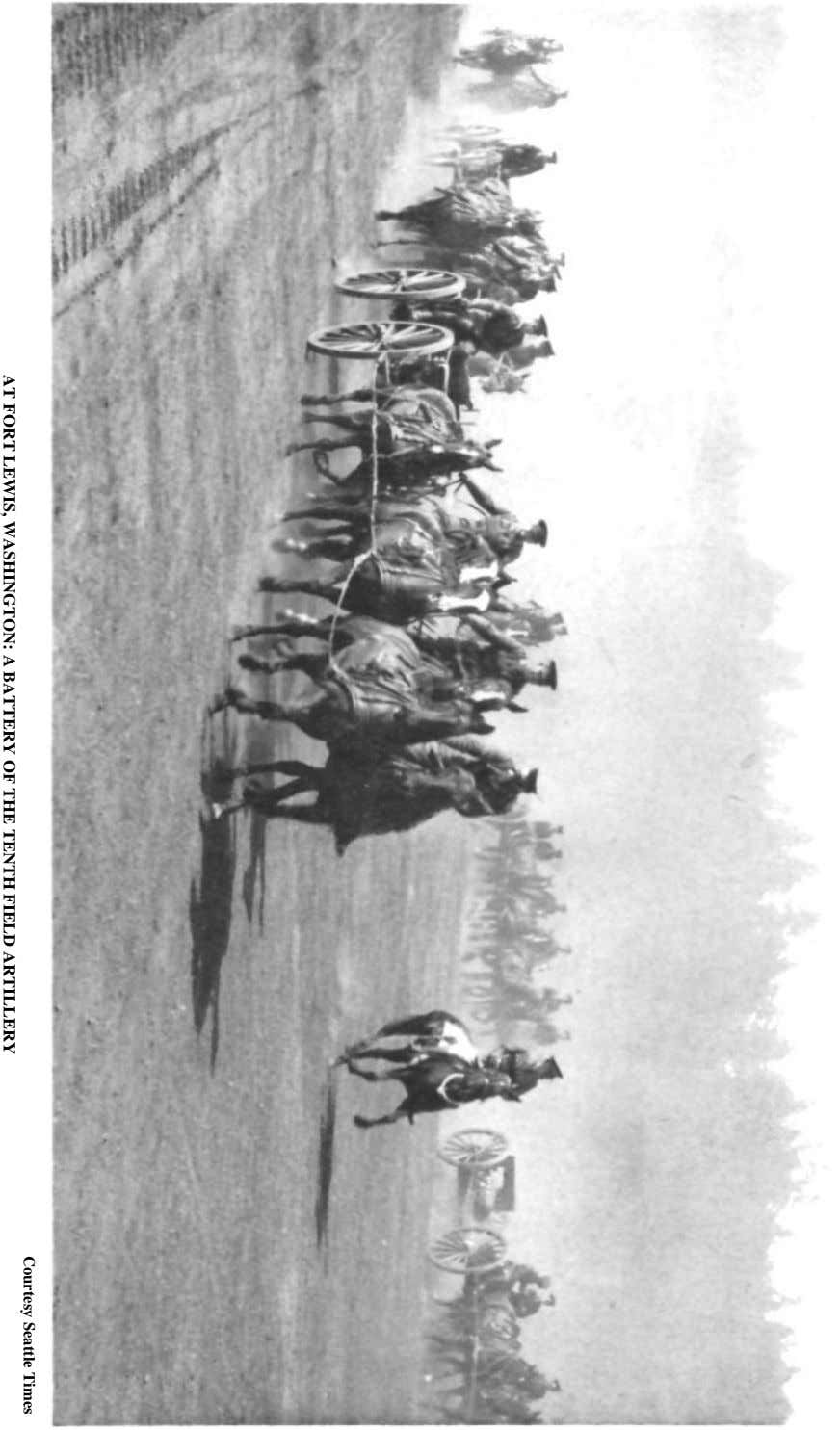 Courtesy Seattle Times AT FORT LEWIS, WASHINGTON: A BATTERY OF THE TENTH FIELD ARTILLERY
