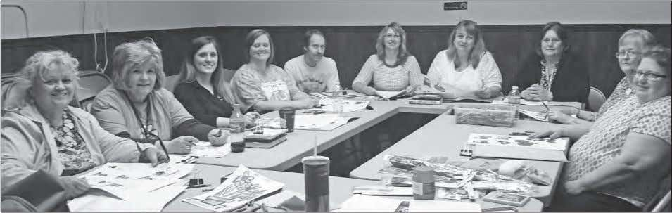 call 419-399-2032, or visit the library on Facebook. Library personnel met recently to make plans for