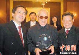 Left: General Chi Haotian, former Chinese Defense Minister, receives the WHF award from Sha Zukang,