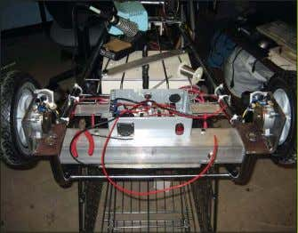 "case ground,"" says Garcia. Motor controller housing unit. BOSS with battery kill switch. BOSS side view,"