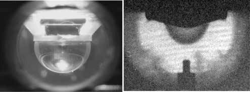 towards the camera came through a hole in the Formvar film. Figure 6. The photo on