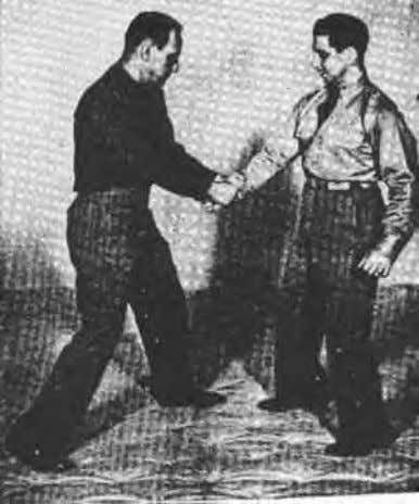 TWO-HAND GRIP ON ONE WRIST. -- Figure 8-1 illustrates your opponent grasping your right wrist with
