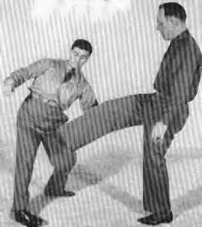 the hips to the right as illustrated in Figure 33-1. This causes your opponent's foot to