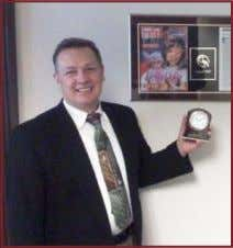 his clock award & plaque commemorating his company being featured on the front cover of a