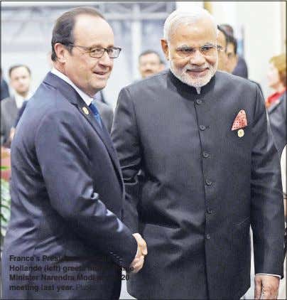 France's President Francois Hollande (left) greets Indian Prime Minister Narendra Modi at a G-20 meeting last