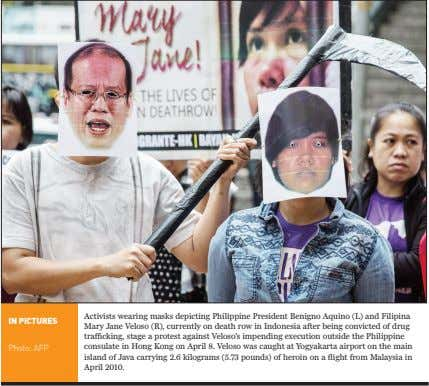 IN PICTUrES Photo: AFP Activists wearing masks depicting Philippine President Benigno Aquino (L) and Filipina Mary