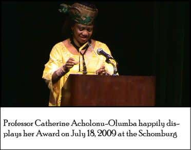 Professor Catherine Acholonu-Olumba happily dis- plays her Award on July 18, 2009 at the Schomburg