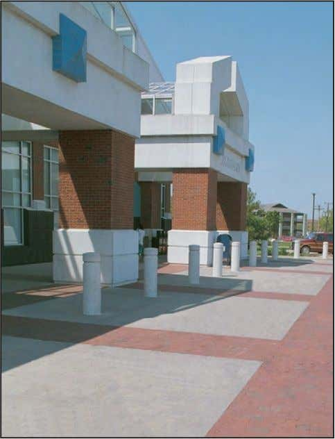 future alterations and difficult visual design problems. ■ This commissary has a curb-less design, with bollards,