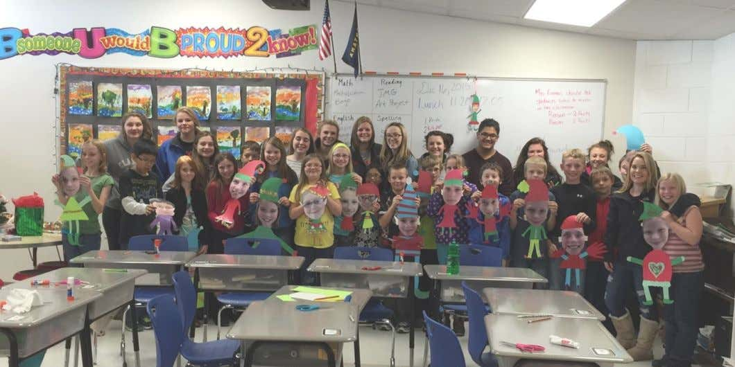 Getting in the Christmas Spirit Mrs. Page's JMG class went to the Irle School and assisted