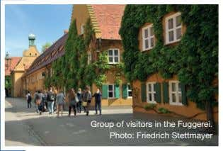 Group of visitors in the Fuggerei. Photo: Friedrich Stettmayer
