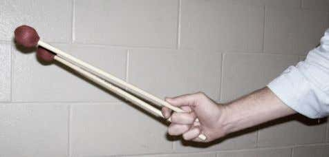 "Mallets ""hang"" in the hand, with minimal tension The pad of the thumb lays flat"