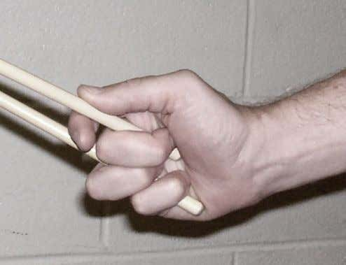 "Mallets ""hang"" in the hand, with minimal tension The pad of the thumb lays flat on"