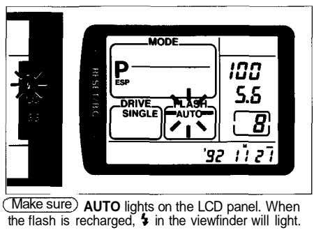 Make sure AUTO lights on the LCD panel. When the flash is recharged, in the