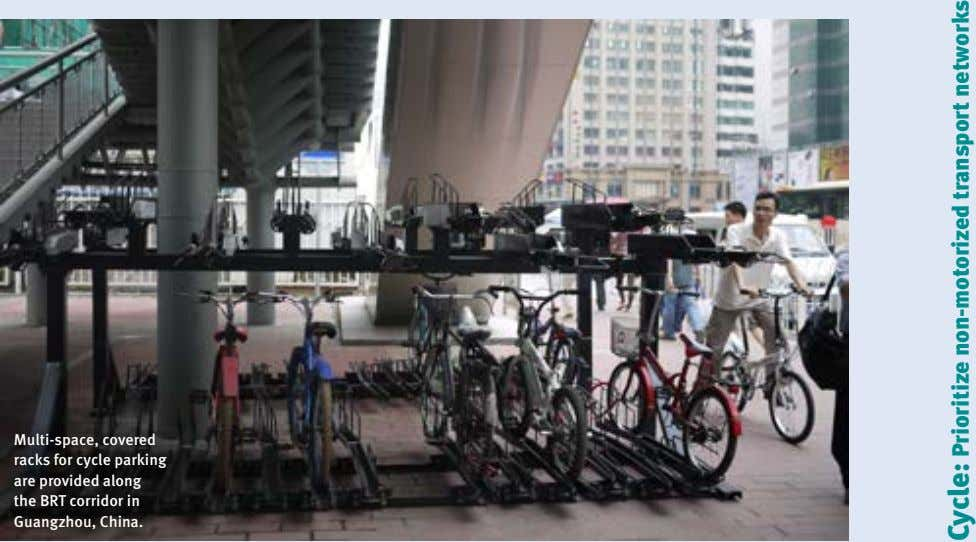 Multi-space, covered racks for cycle parking are provided along the BRT corridor in Guangzhou, China.