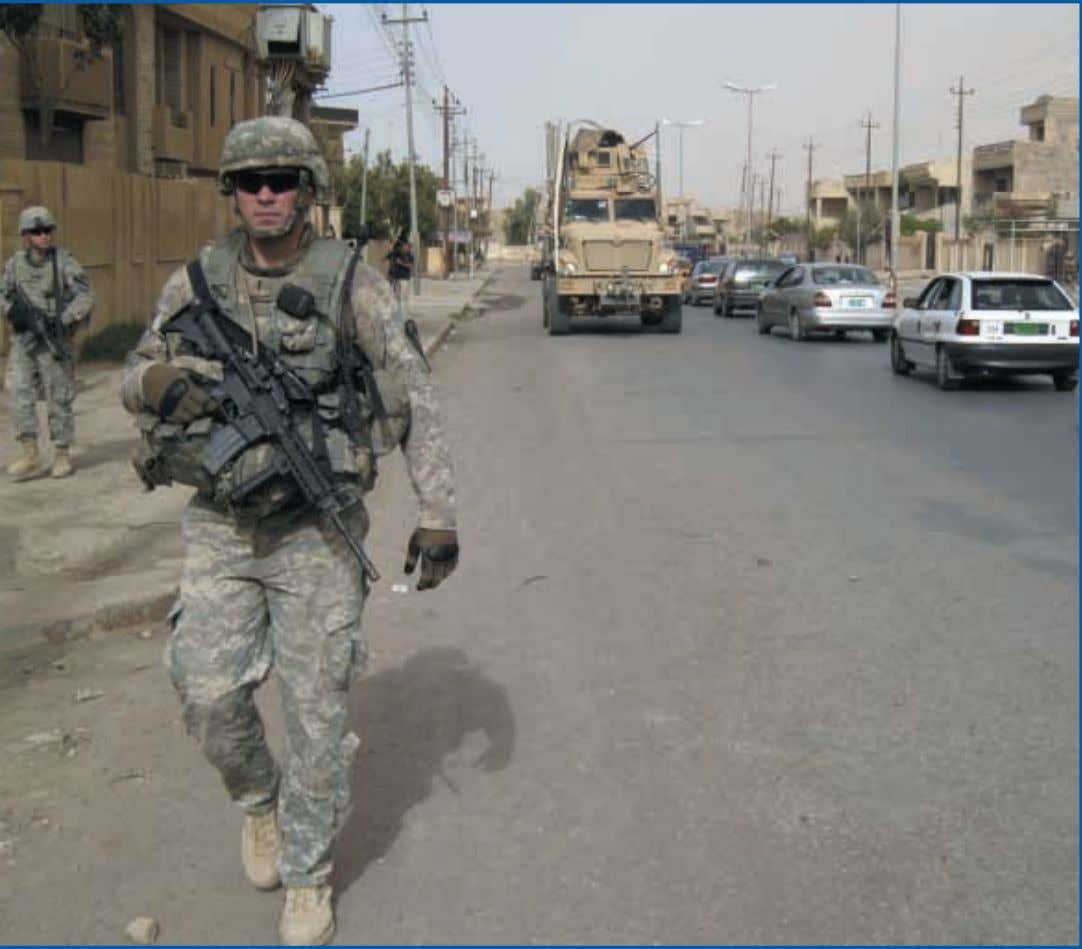 militant Islamic groups, including some supported by the U.S. troops patrol the streets of war-torn Baghdad,