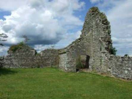 Remains of the Augustinian Church and later medieval Parish Church of Aghmacart, facing south View