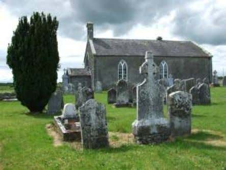 Church and later medieval Parish Church of Aghmacart, facing south View of the church and memorials,
