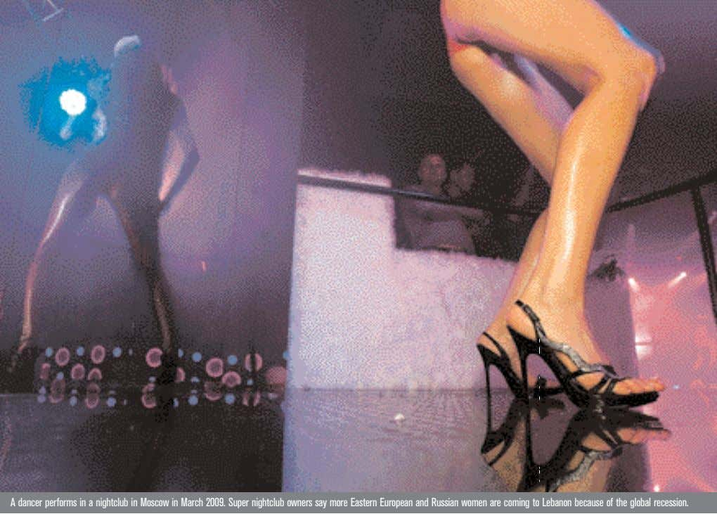 A dancer performs in a nightclub in Moscow in March 2009. Super nightclub owners say