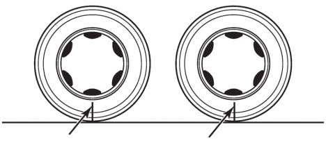 and rear tires at identical relative positions.Figure 4.16 MARKS MARKS Figure 4.16 6.Turn the forward driveshaft