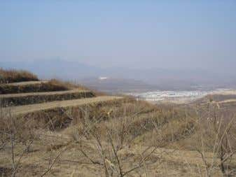 Source: MJS Figure 5. Terraced fields, Shandong Province. Source: Author's photo Figure 6. Boulder showing the