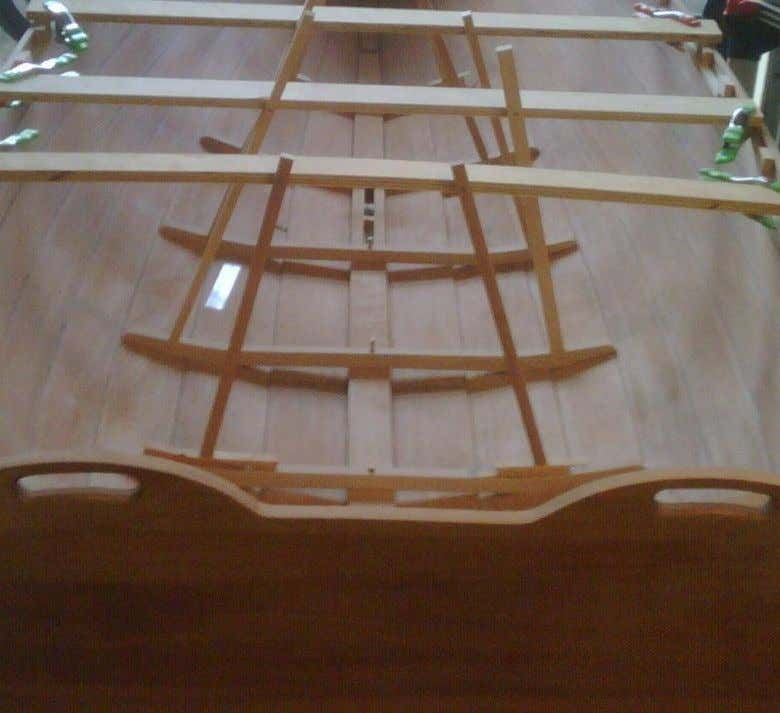 Alder floors are glued to the hull using homemade clamps sprung to the gunwale .