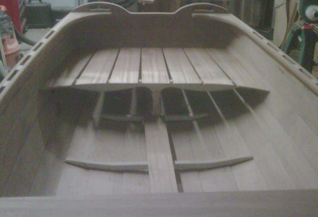 Mahogany inwale is installed. Mahogany stern sheets and center thwart are laid up for final