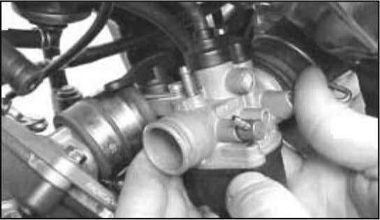 return spring against the cover and extract the throttle cable terminal through the channel in the