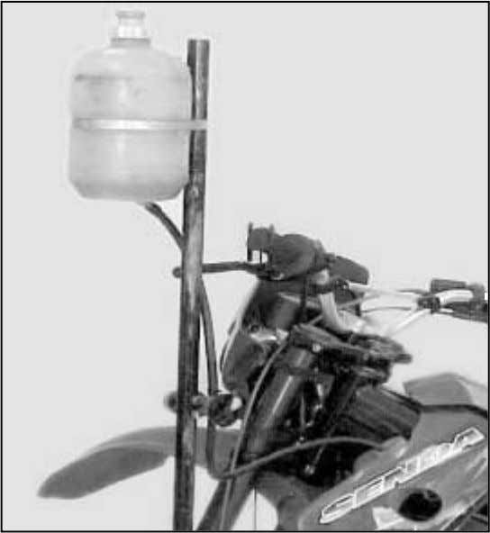 cock and allow the coolant fluid to flow freely until the minimum level in the expansion