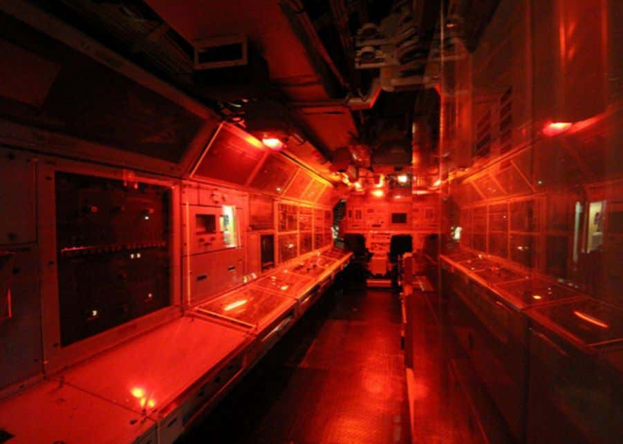 during high alert and/or exercises. Also, throughout the rest of the ship, they'd use red lights